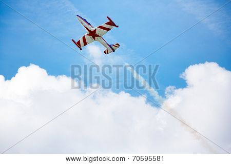 acrobat in movement of air show airplane on the sky