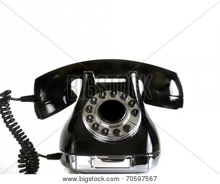 Retro vintage dial rotary phone black isolated against white background.