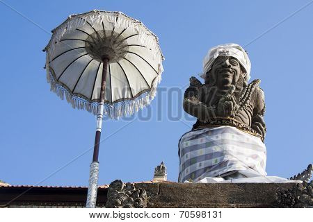 Balinese Statue And Umbrella