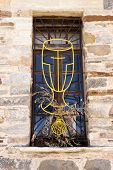foto of chalice  - Chalice wrought iron window in pilgrims hostel in Villafranca del Bierzo Spain - JPG