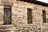 image of chalice  - Chalice wrought iron windows in pilgrims hostel in Villafranca del Bierzo Spain - JPG