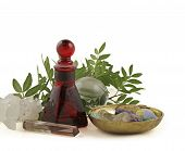 stock photo of essential oil  - Red glass essential oil bottle - JPG