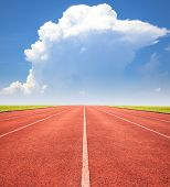 image of olympiade  - red running track over blue sky and clouds - JPG
