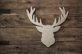 foto of antlers  - Vintage rustic christmas decoration with antler on wooden brown background - JPG