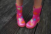 foto of shy girl  - Cute little girl legs in rubber boots  - JPG