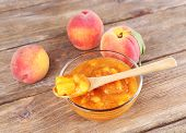 foto of peach  - tasty peach jam with fresh peaches on wooden table - JPG