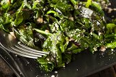 foto of sauteed  - Homemade Healthy Sauteed Swiss Chard with Garlic and Cheese - JPG