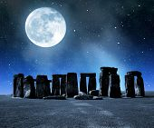 foto of stonehenge  - Historical monument Stonehenge with moon in night - JPG