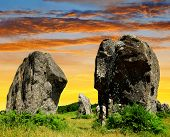 picture of megaliths  - Sunset above the Megalithic monuments menhirs in Carnac - JPG