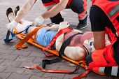 stock photo of breath taking  - Paramedics taking woman to the hospital horizontal - JPG