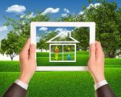 stock photo of public housing  - Hands hold tablet pc with symbols of public service and house - JPG