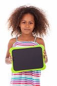 foto of black american  - African American school girl holding a blank black board isolated on white background  - JPG