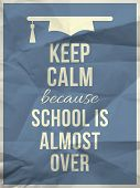 stock photo of calm  - Keep calm because school is almost over design typographic quote on light blue crumpled paper texture with graduation hat icon - JPG