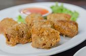 picture of crab-cakes  - close up deep fried crab meat roll cake on white dish chinese food