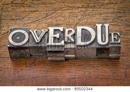 overdue word in mixed vintage metal type printing blocks over grunge wood