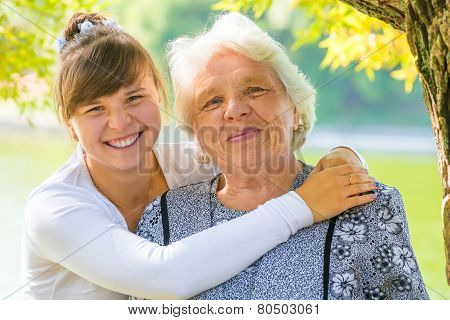 Young Girl Hugging Her Beloved Grandmother