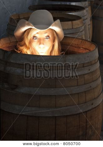 Humorous Photo Of A Girl In A Barrel