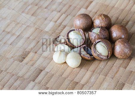 Macadamia On Wood Table.
