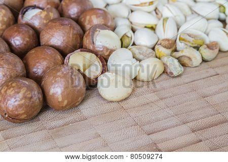 Macadamia And Pistachio Nut On Wood Table.