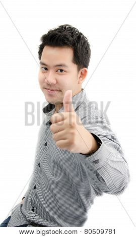 Portriat Of Young Man Looking At Camera With Thump Up