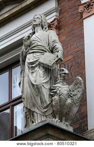 VIENNA, AUSTRIA - OCTOBER 10: Saint John the Evangelist on the facade of Evangelical School in Vienna, Austria on October 10, 2014.