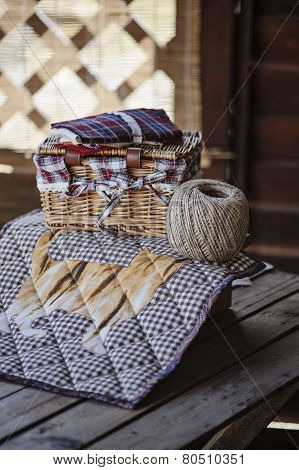 handmade quilt blanket with twine and sewing tools