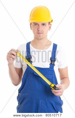 Man Builder In Blue Coveralls Holding Measure Tape Isolated On White