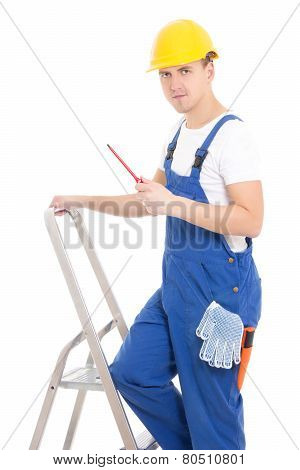 Young Man Builder In Blue Coveralls With Screwdriver On Ladder Isolated On White