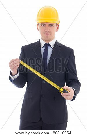 Handsome Business Man Or Architect In Yellow Builder's Helmet With Measure Tape Isolated On White