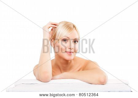 picture of woman in spa salon lying on white towel