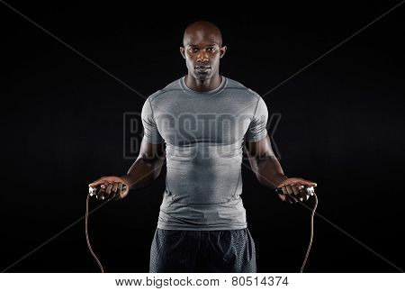 Masculine Man Skipping Rope In Dark