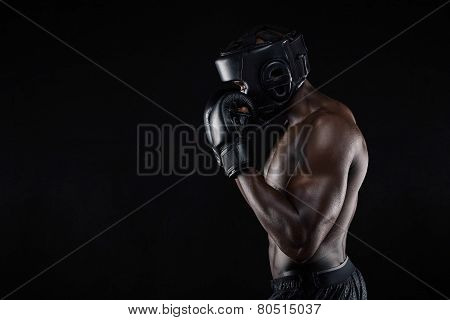 African Male Boxer Blocking His Face With Gloves