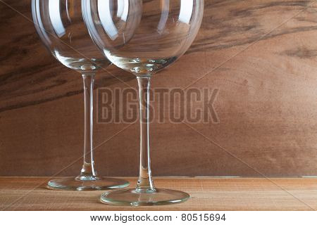 Two Glasses Of Wine On The Wooden Background