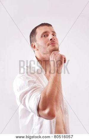 Young Man Dressed In White Unbuttoned Shirt