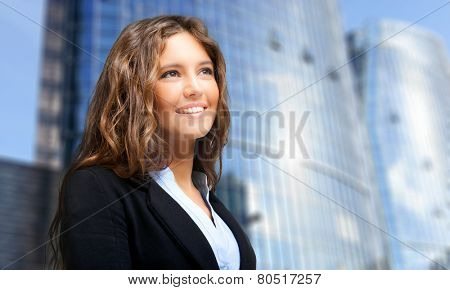 Successful young woman looking straight forward in an urban setting