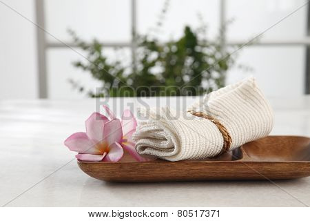 spa concept flower and the hand towel in a bath room