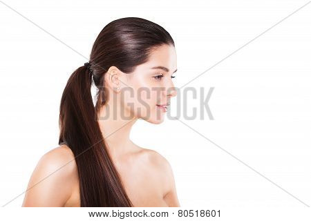 Beauty brunette fashion model girl with long straight brown hair, ponytail hairstyle.