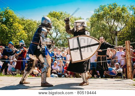 Knights In Fight With Sword. Restoration Of Knightly Battle