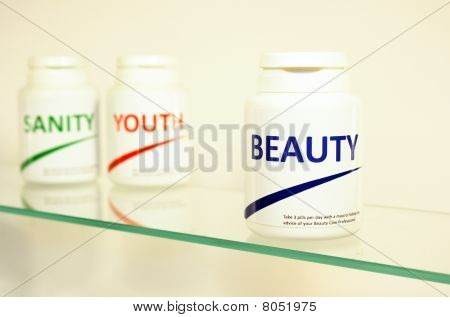 Sanity, Beauty And Youth Pills In A Bottle On Bathroom Shelf