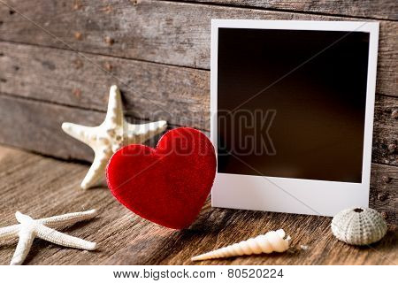 Photo Frames And Valentines Day  Heart Over Wooden Background