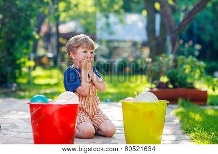 Little Toddler Boy Having Fun With Splashing Water In Summer Garden.