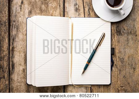 Notebook With Fountain Pen And Cup Of Espresso