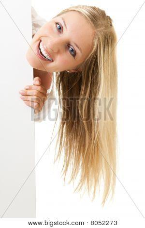 Woman peeping from whiteboard
