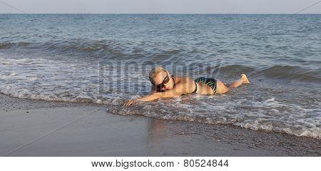 Beautiful girl on sea beach