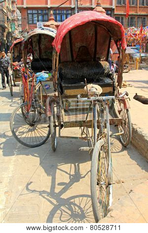 KATHMANDU, NEPAL - APRIL 2014 : A group of 3 wheeled rickshaws waiting for customers in Kathmandu, Nepal on 12 April 2014.