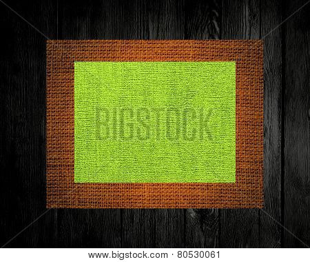 lime linen rustic canvas textured on dark wood background