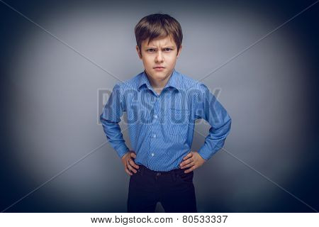 portrait of a teenage boy frowning brown hair European appear
