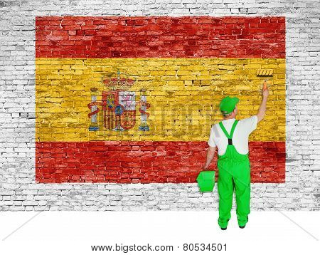 House Painter Paints Flag Of Spain On Brick Wall