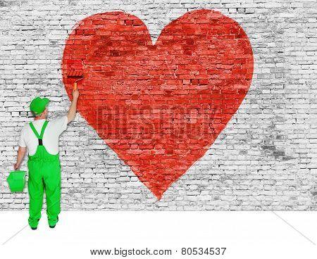 House Painter Paints Symbol Of Broken Love On Brick Wall