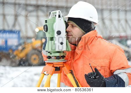 Surveyor At Construction Site In Winter Season